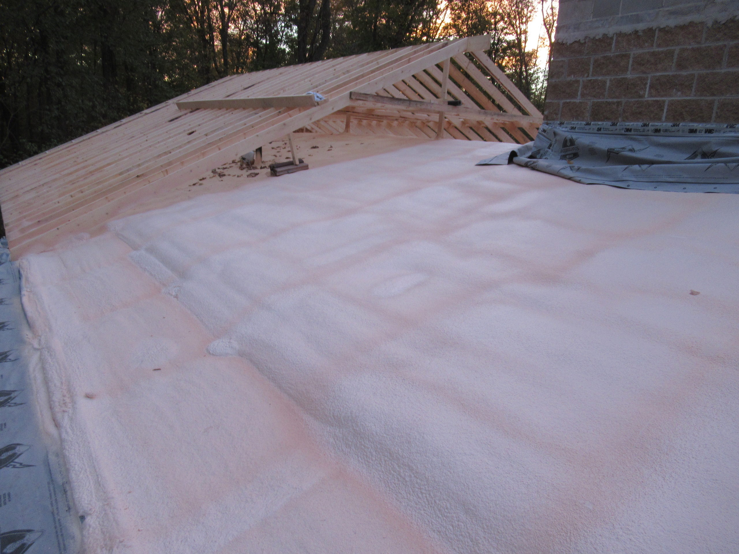 a roof built over an existing roof and insulation added